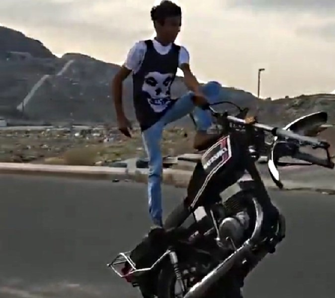 Teen male on a motorcycle